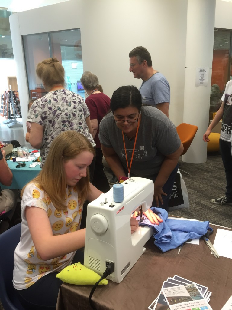 Me helping a young lady to sew her bag