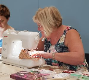 Jan sewing in the piping workshop